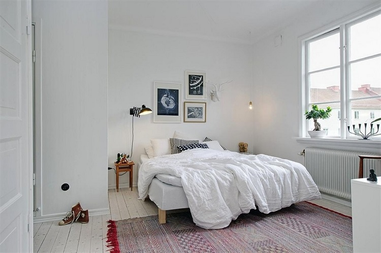 картины в скандинавской спальне